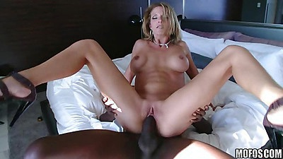 MIlf sitting on black cock with tits going up and down