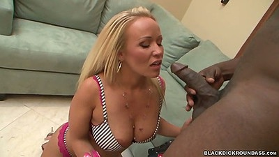 Austin Taylor leaning over to suck and sit on big black cock