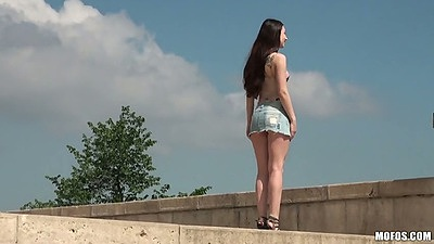 Stacy Snake wearing a tight mini skirt outdoors posing giving upskirts views