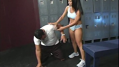 Athletic latina Cassandra Cruz takes care of mans pants in locker room