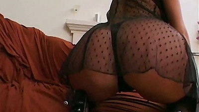 Big ass Sophie Evans in sexy see through lingerie sucking black cock
