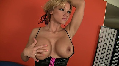 Nikki Sexx shows off her big milf tits in lingerie
